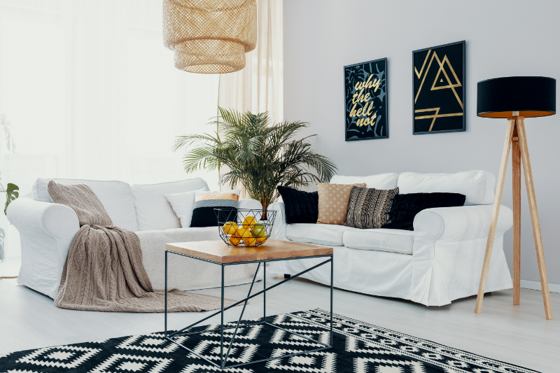 white corner couch with rug